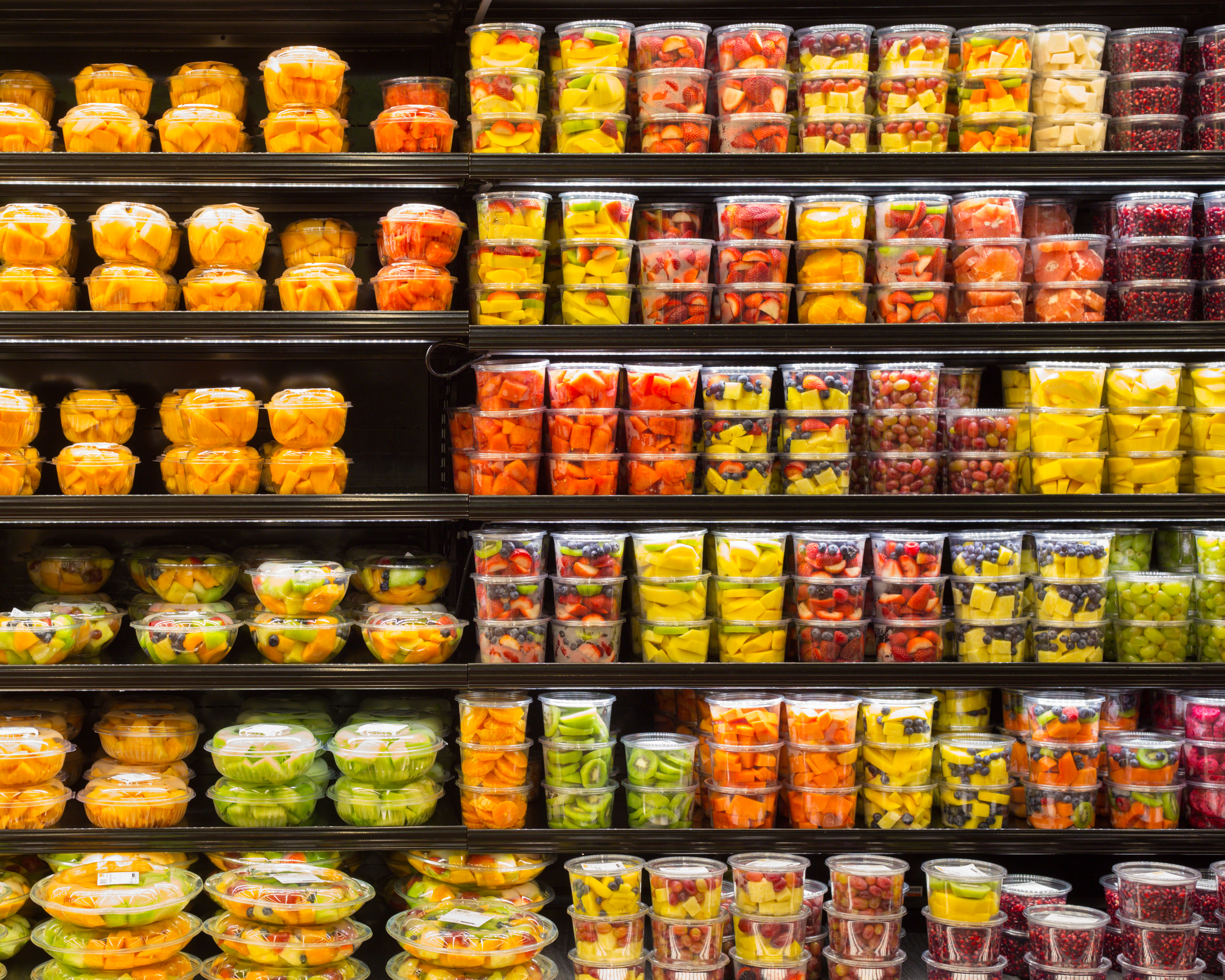 Assortment of cut fruit in containers on display for sale at FNGs remain popular Grab N' Go items at all stores.